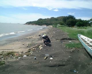 Collecting plastic resin pellets on Hong Kong beach